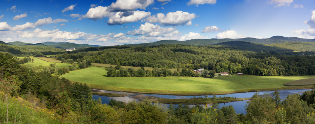 A panorama of the lush green countryside of the State of Vermont