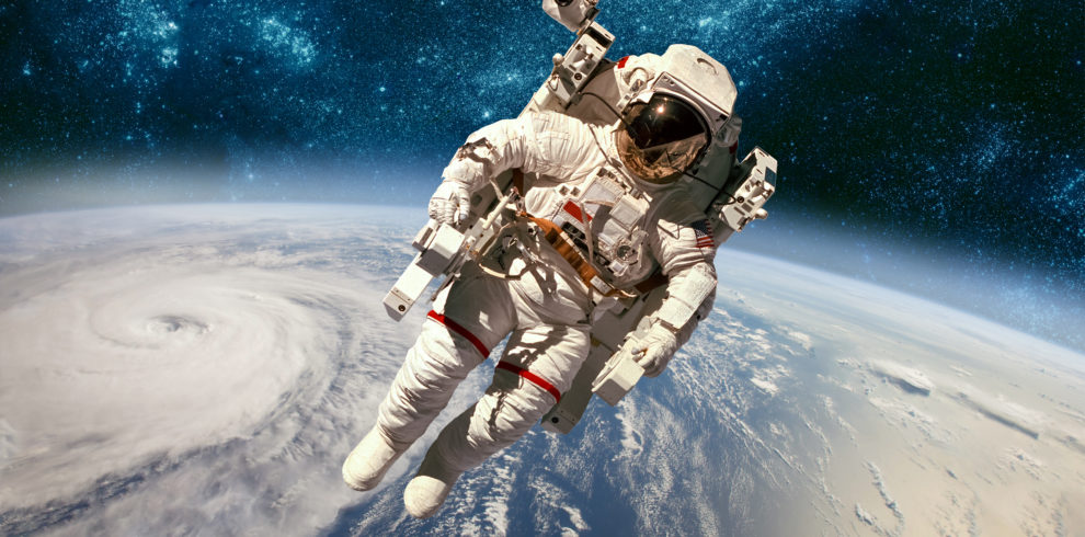 Astronaut in outer space against the backdrop of the planet eart