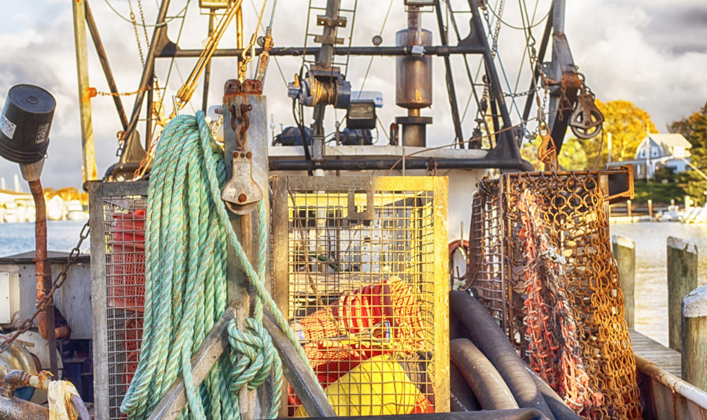 The Fishing And Lobster Traps And Rigging On The Back Of A Fishi