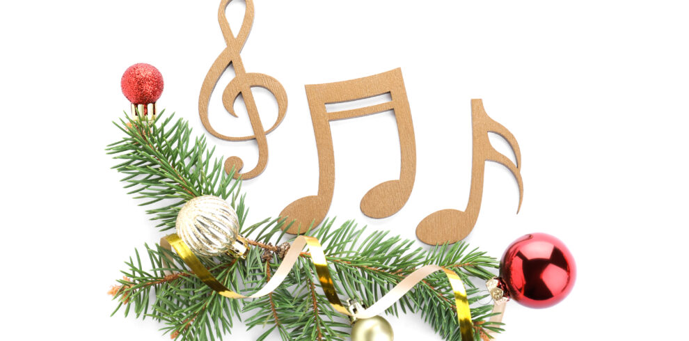 Fir Tree Branches With Wooden Music Notes And Christmas Decor On