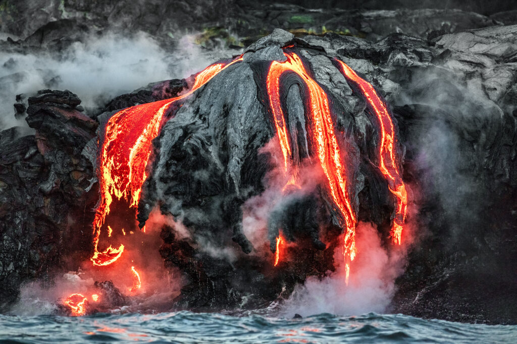 Hawaii lava flow entering the ocean on Big Island from Kilauea v