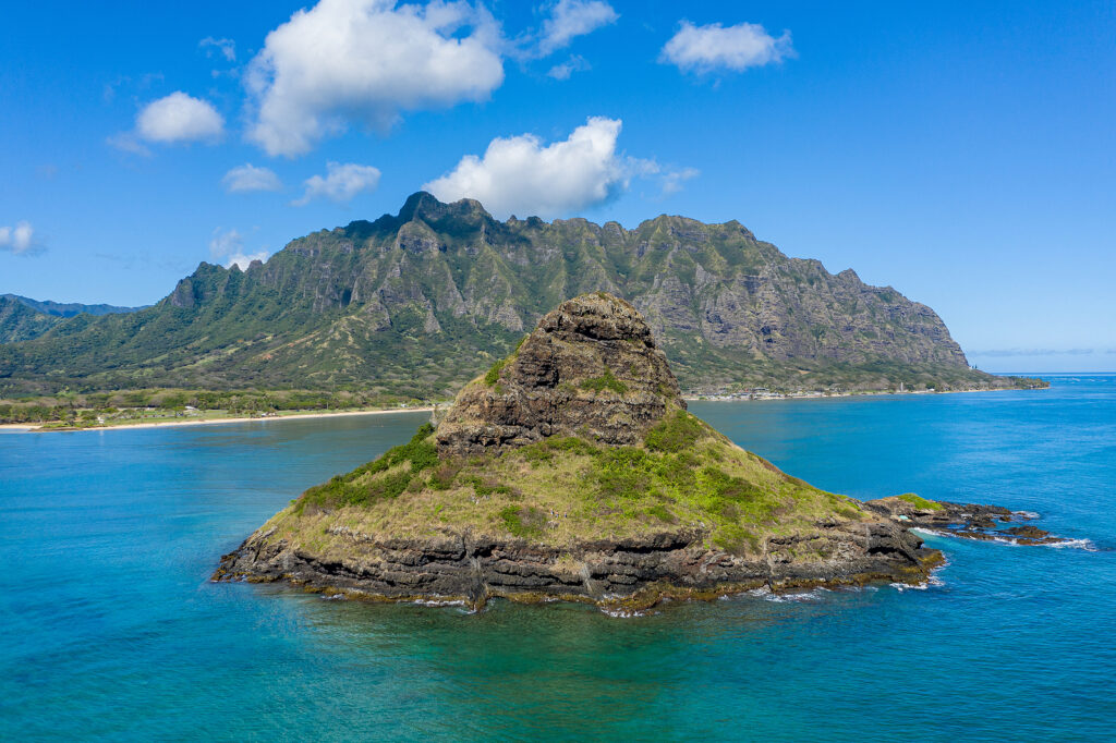 Aerial View Of The Chinamans Hat With Kualoa Beach And Park With
