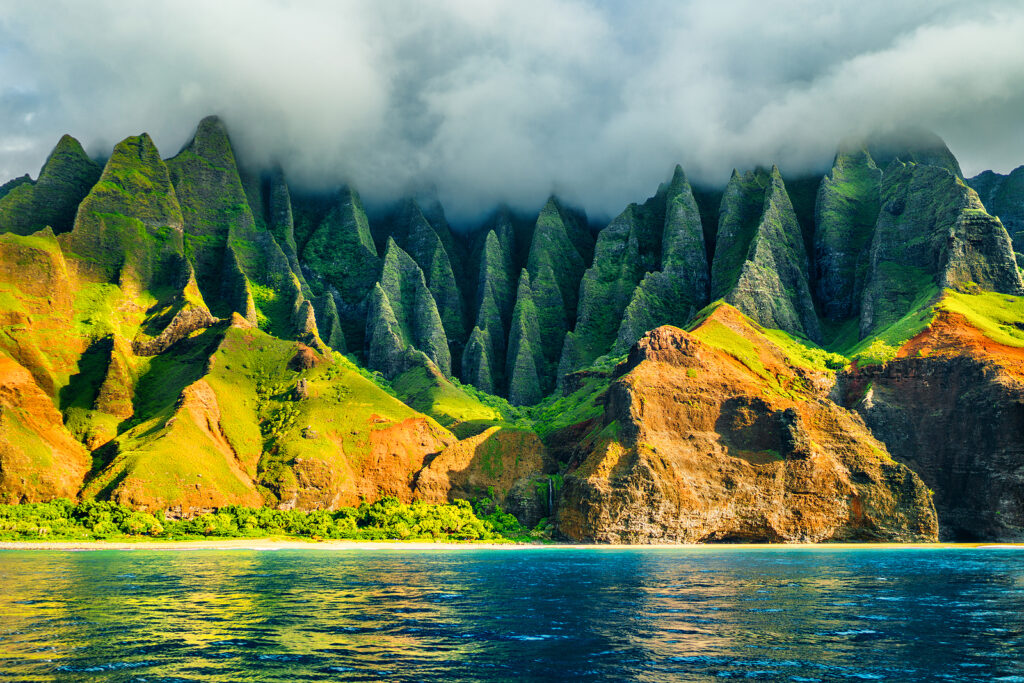 Na Pali coast, Kauai, Hawaii view from sea sunset cruise tour. N