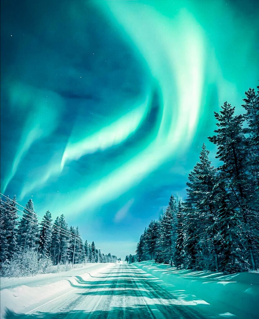 Colourful Northern Lights In Night Sky. Multicoloured Green Vibr