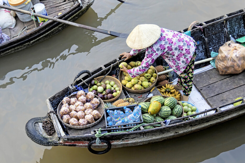 Phan Thiet, Vietnam – July 12th, 2020. Greengrocer On Wooden Flo