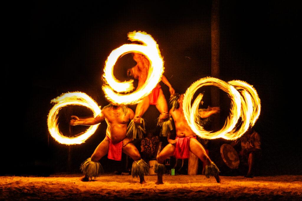 Luau hawaiian fire dancers motion blur tourist attraction in Haw